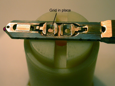 A JEM-1010 locking flange with the sample in place.